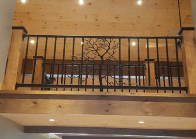 Tree shaped cutout centered in a railing section